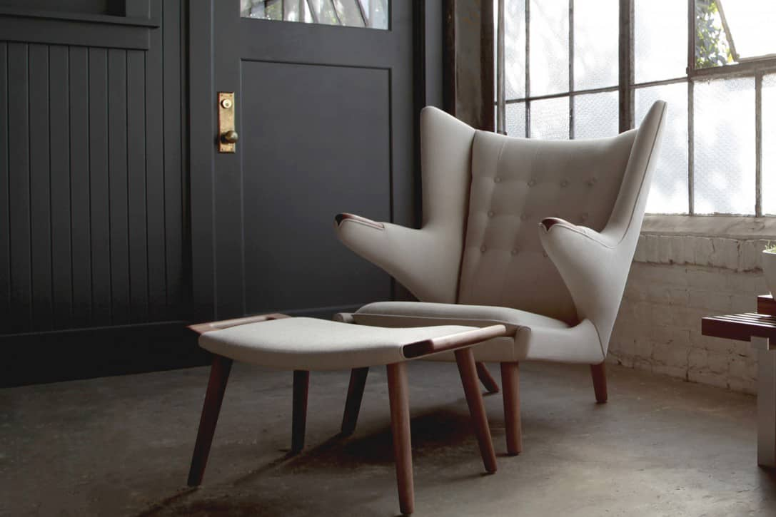 modern cream reading chair with footrest