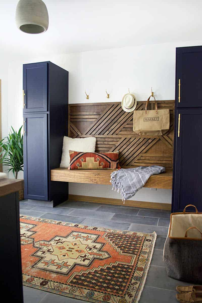 navy mudroom with floating bench