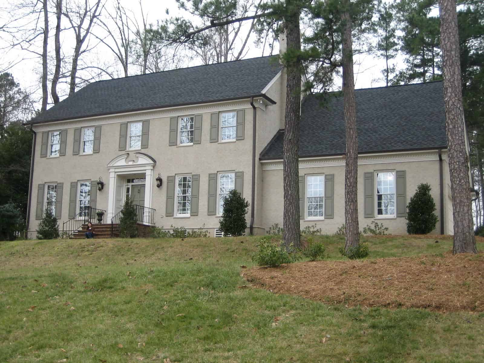 painted brick colonial home