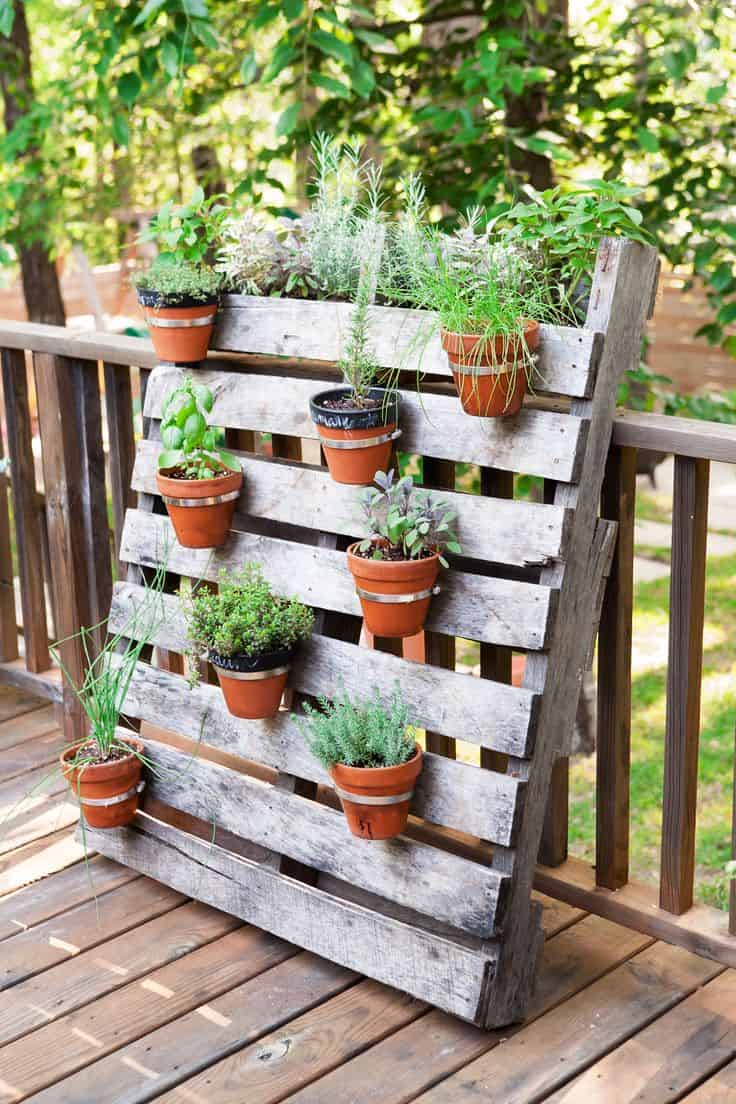 A pallet garden adds color, as well a natural feel to your patio or porch area. Choose plants that can survive a higher temperature increase.