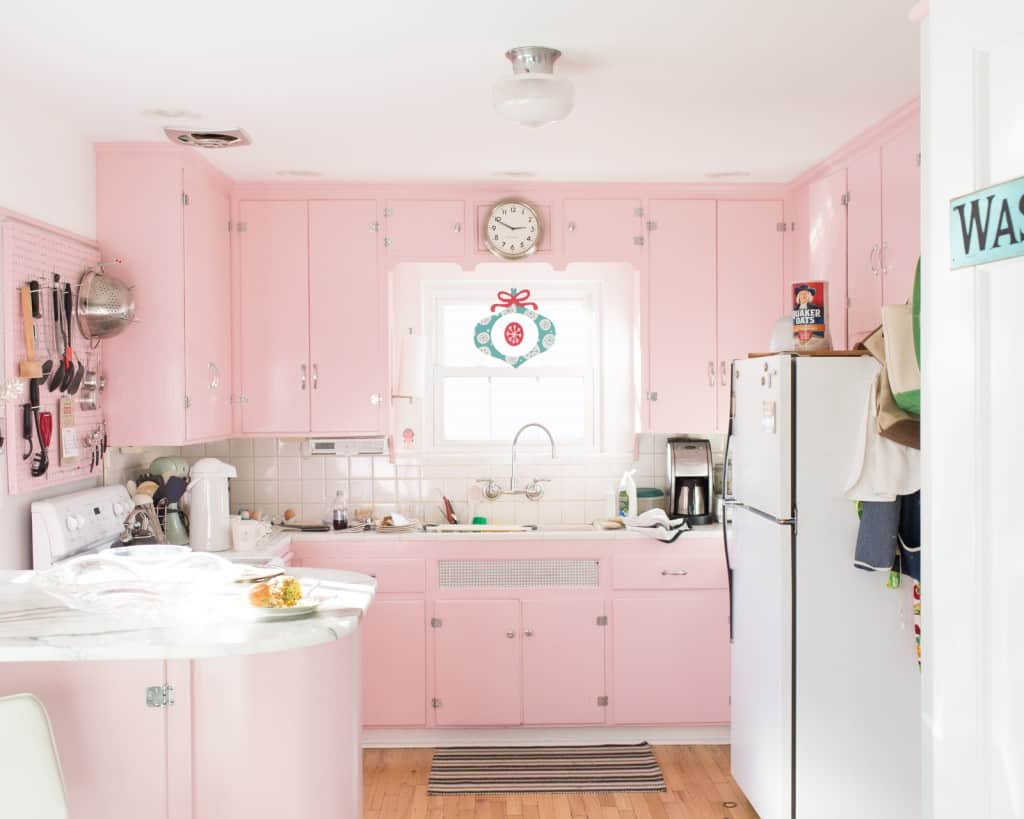 If pink appliances seem to be too much for you to have in your kitchen you can choose to paint your cabinets pink instead.