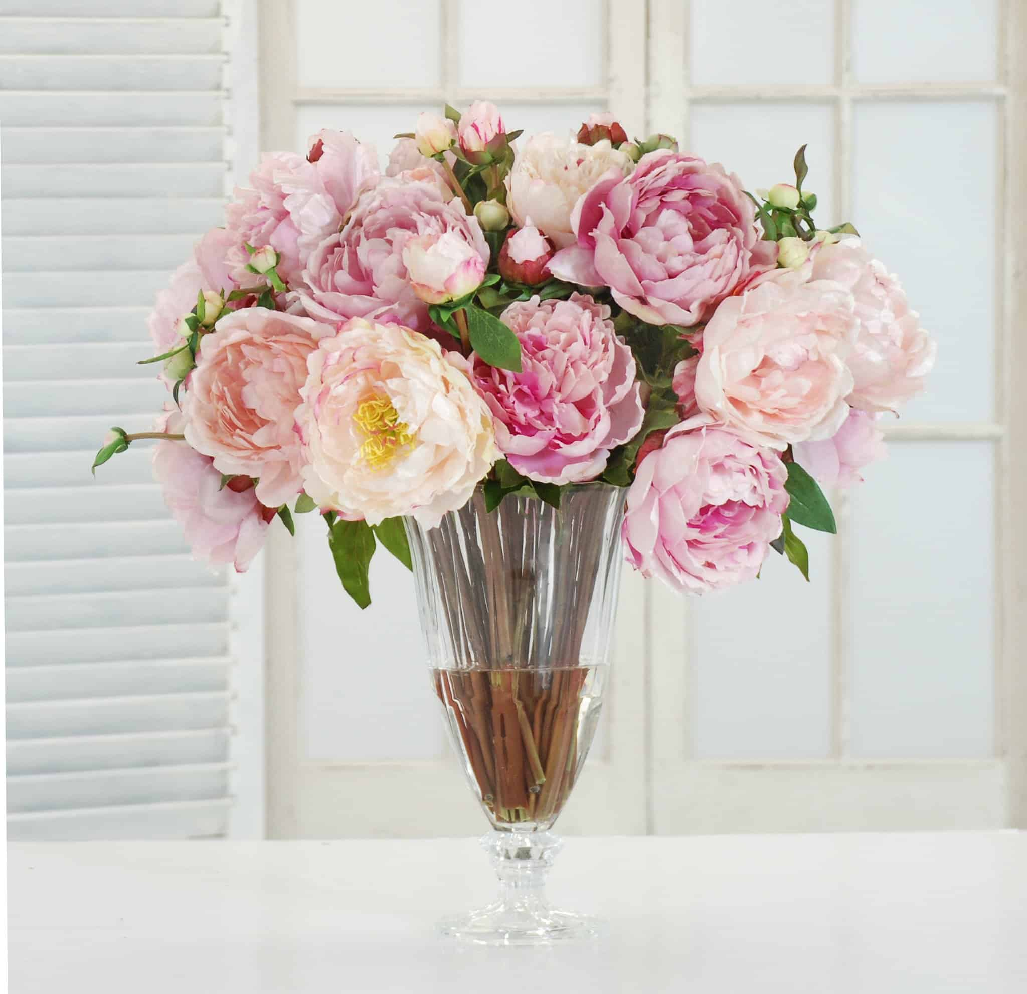 hoose different shades of pink for your flower arrangements as well as add white ones to make the different shades stand out.