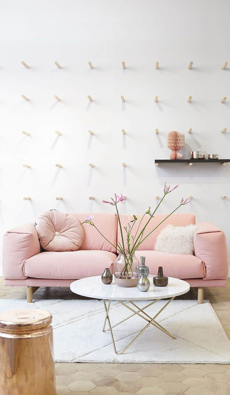 Pastel pink is the perfect shade for your sofa in a room