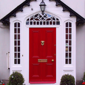 Don't just paint the indoor of your home's door red, paint the outside as well.