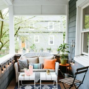 If you happen to have a smaller porch add a small seating area with a nice rug and small tables. This will create an extension of your living room.