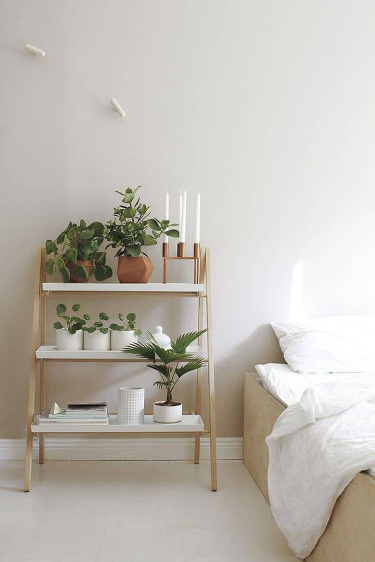 white clean minimal bedroom with plants