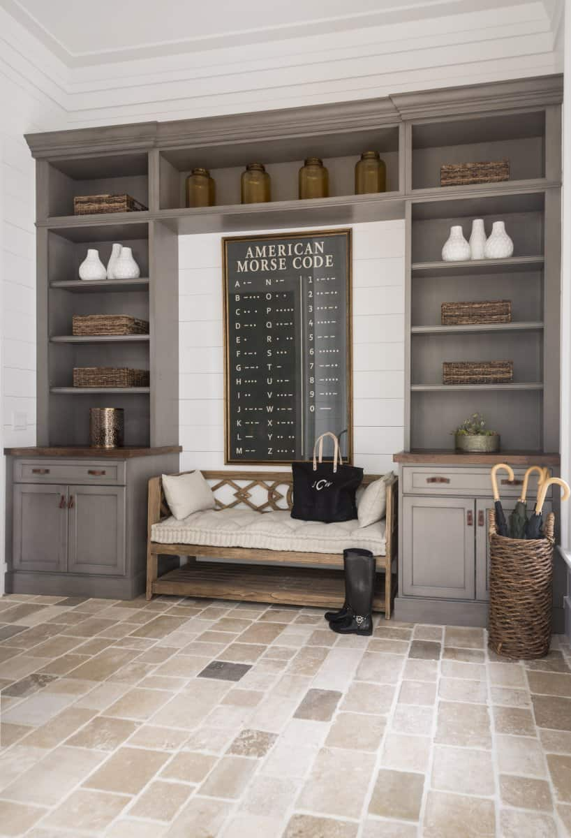 wooden rustic sitting bench in mudroom