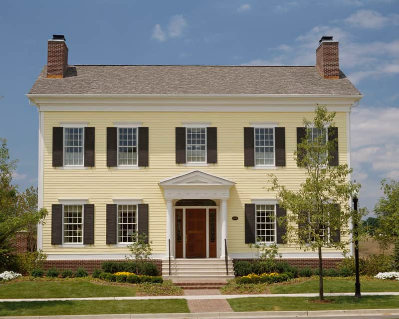 yellow colonial style home These 15 Colonial Style Homes Will Have You Feeling Warm and Cozy