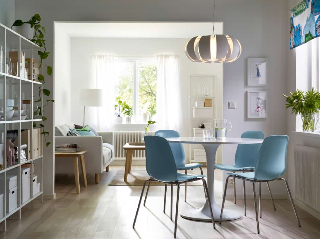 Your dining table does not need to be large for the blue chairs to make an impact.