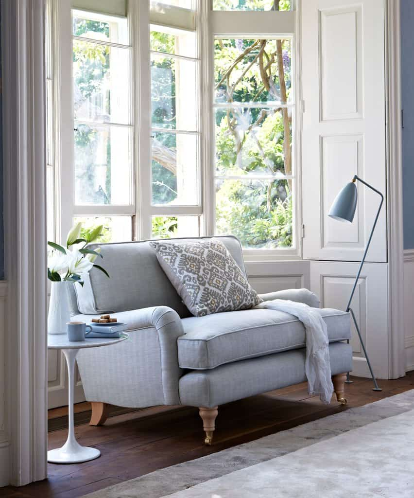 A sofa in front of a large window can do the trick that you seek.