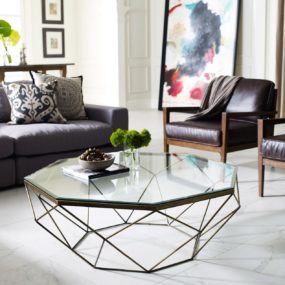 A modern geometric shape will add an interesting take on a traditional coffee table.