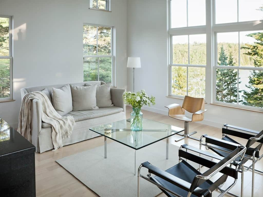 Glass tables are great they are lightweight and help expand the space.
