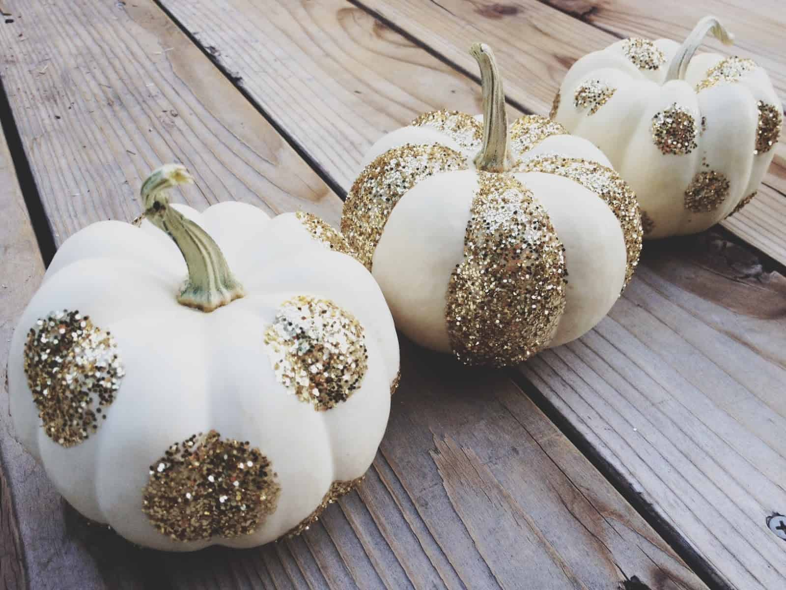 Forget just painting your pumpkin a bold color add glitter polka dots to them instead or you can do both.