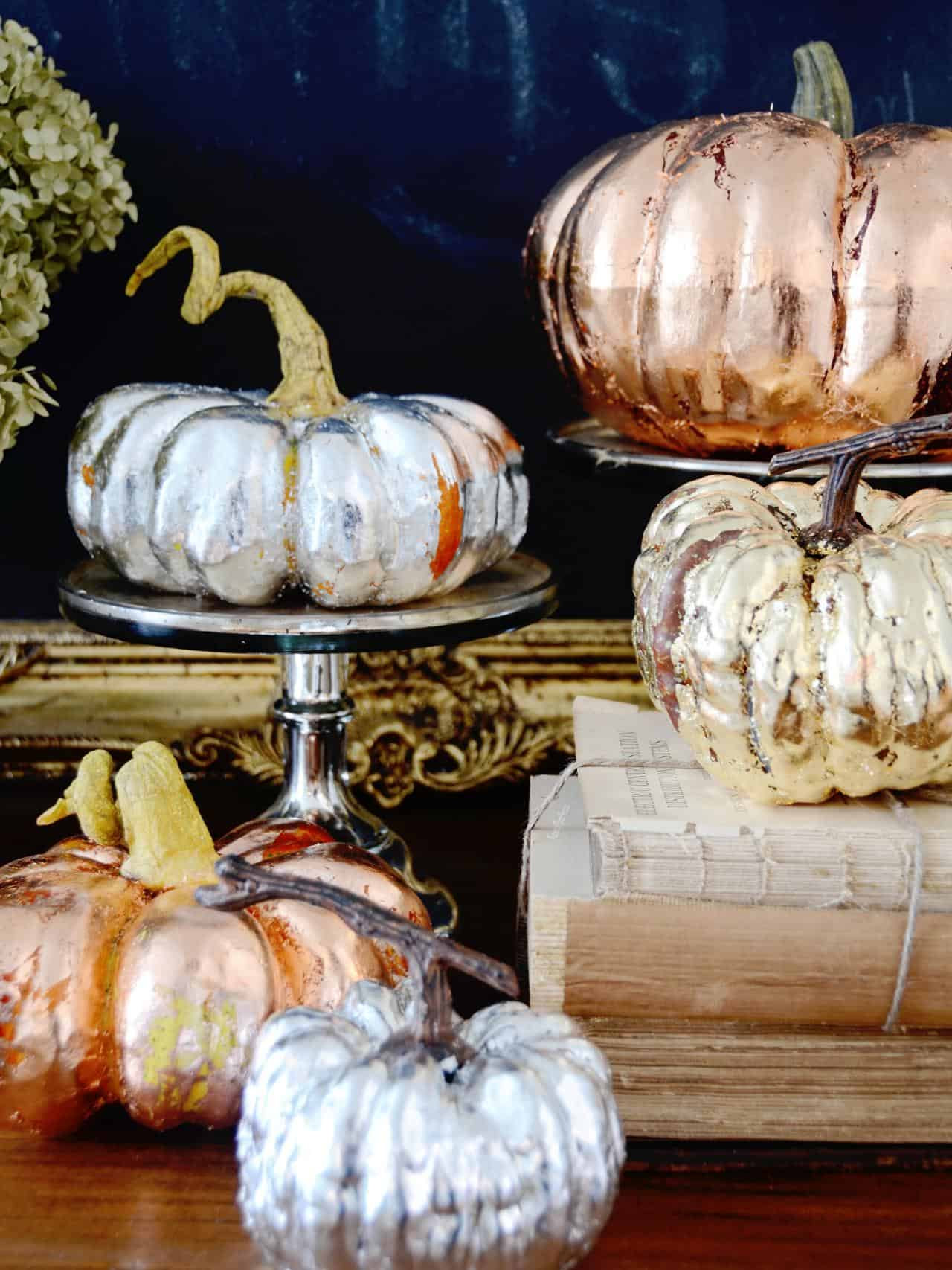 Metallic pumpkins are easy to recreate and make such a huge impact in any space they are placed in