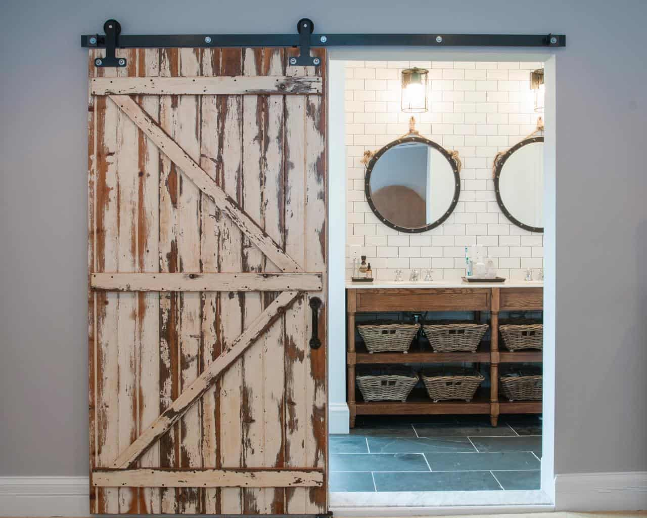 If you decide to use barn doors as a bathroom door with a twist consider not painting the door for a rustic upgrade.