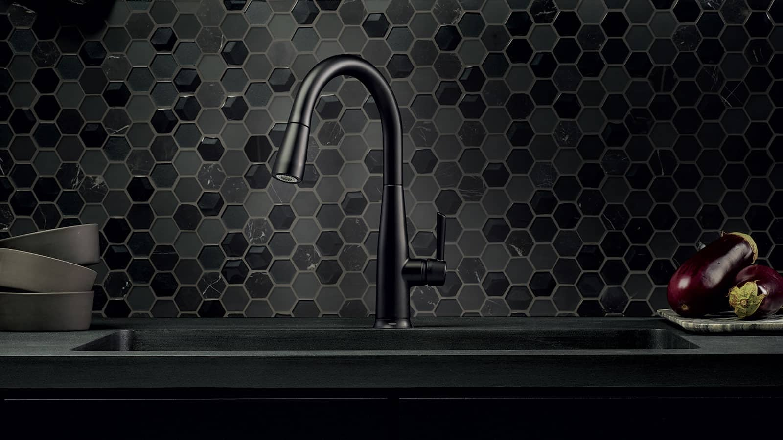 The elegance a black faucet adds to a kitchen is indescribable.