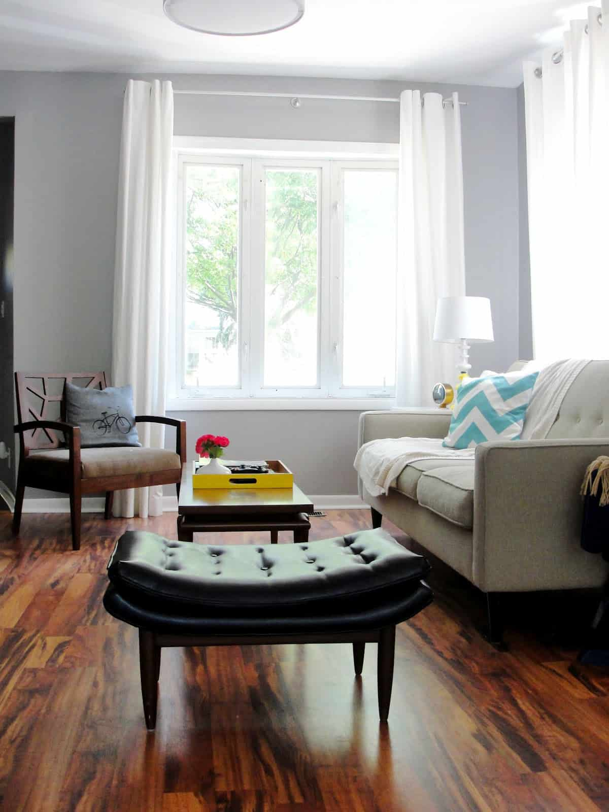 living room without a rug2 Decorating Mistakes That Make Your Home Feel Smaller