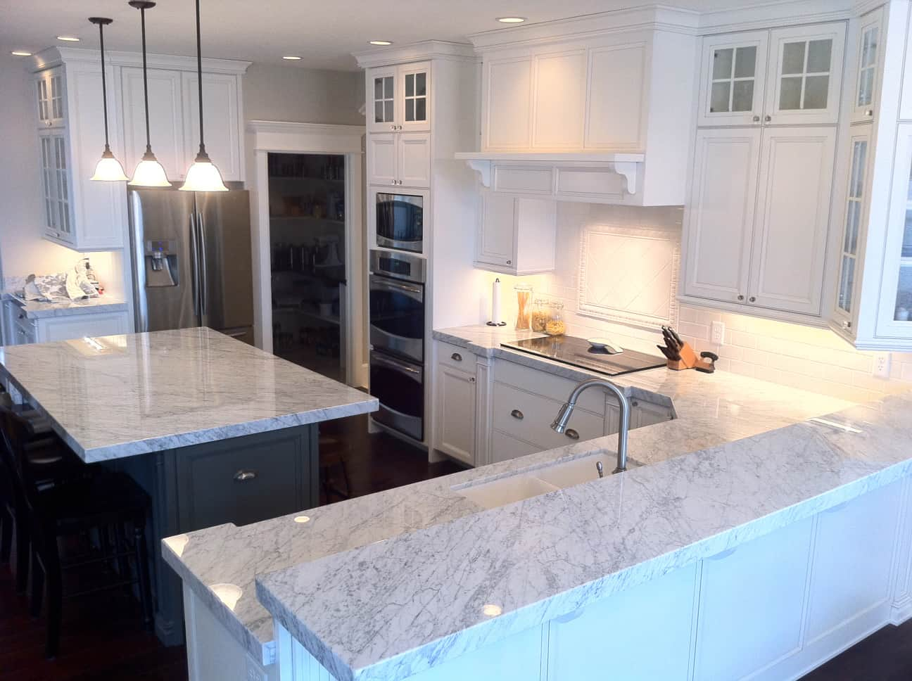Marble is fresh, clean, and trendy. Therefore, having a marble kitchen island paired with a contrasting color such as black makes a bold yet unique contrast between the two.