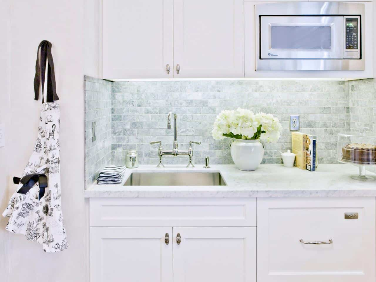 Take your tile backsplash one step further and create a simple yet subtle design that may be hard to see from afar but will catch your attention.