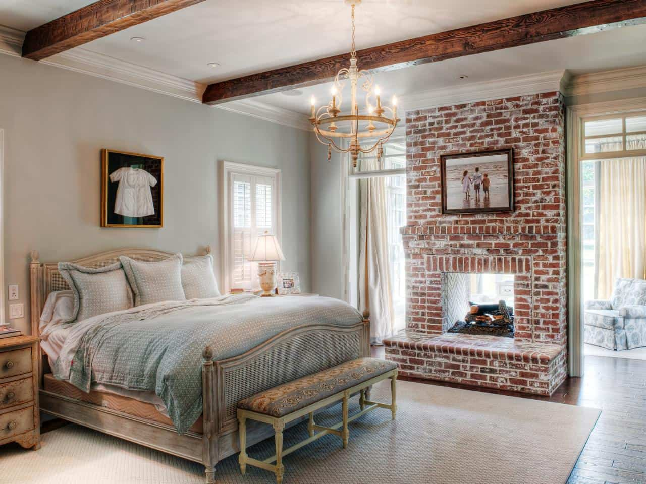 A brick fireplace works perfectly in a bedroom because it adds an extra touch of warmth in the room in the most subtle way.