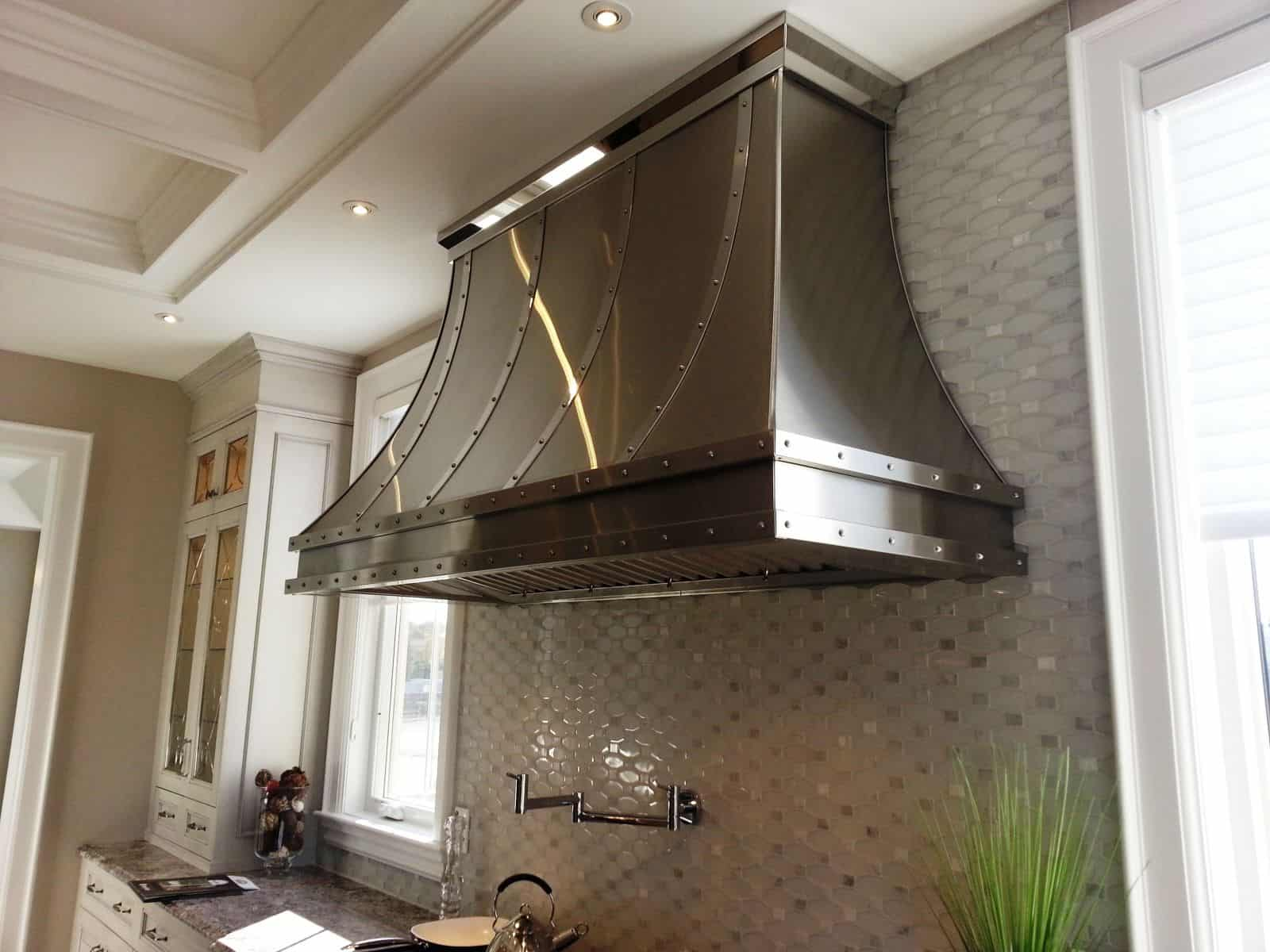 There is something very edgy yet country chic about having a metal hood in your kitchen.
