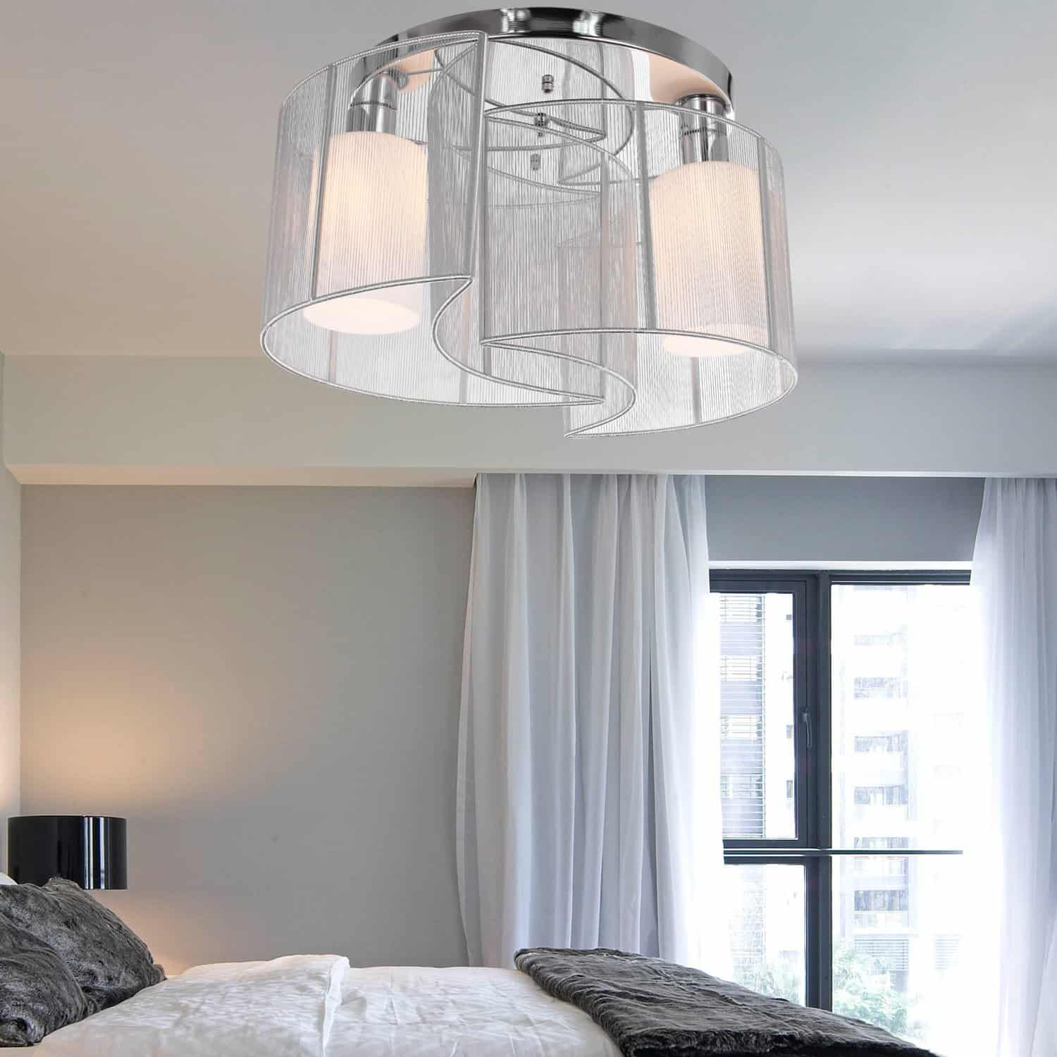 Just by having a metallic light fixture in the room you can help expand the space of the room visually