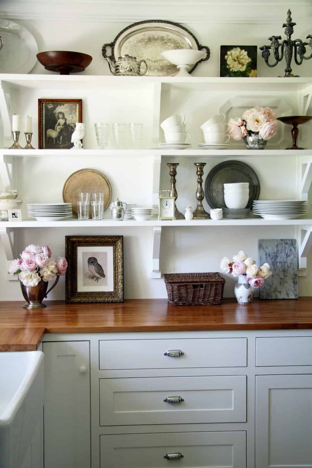 open shelving in kitchen with white shelves