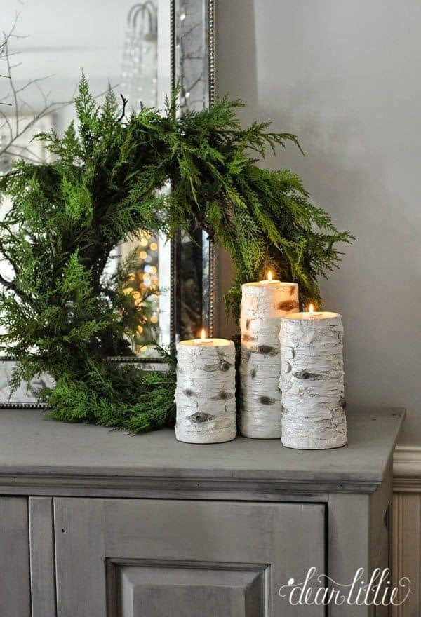 winter decor for the home green wreath and wood candle 15 Pieces Of Winter Style Youll Want For Your Home