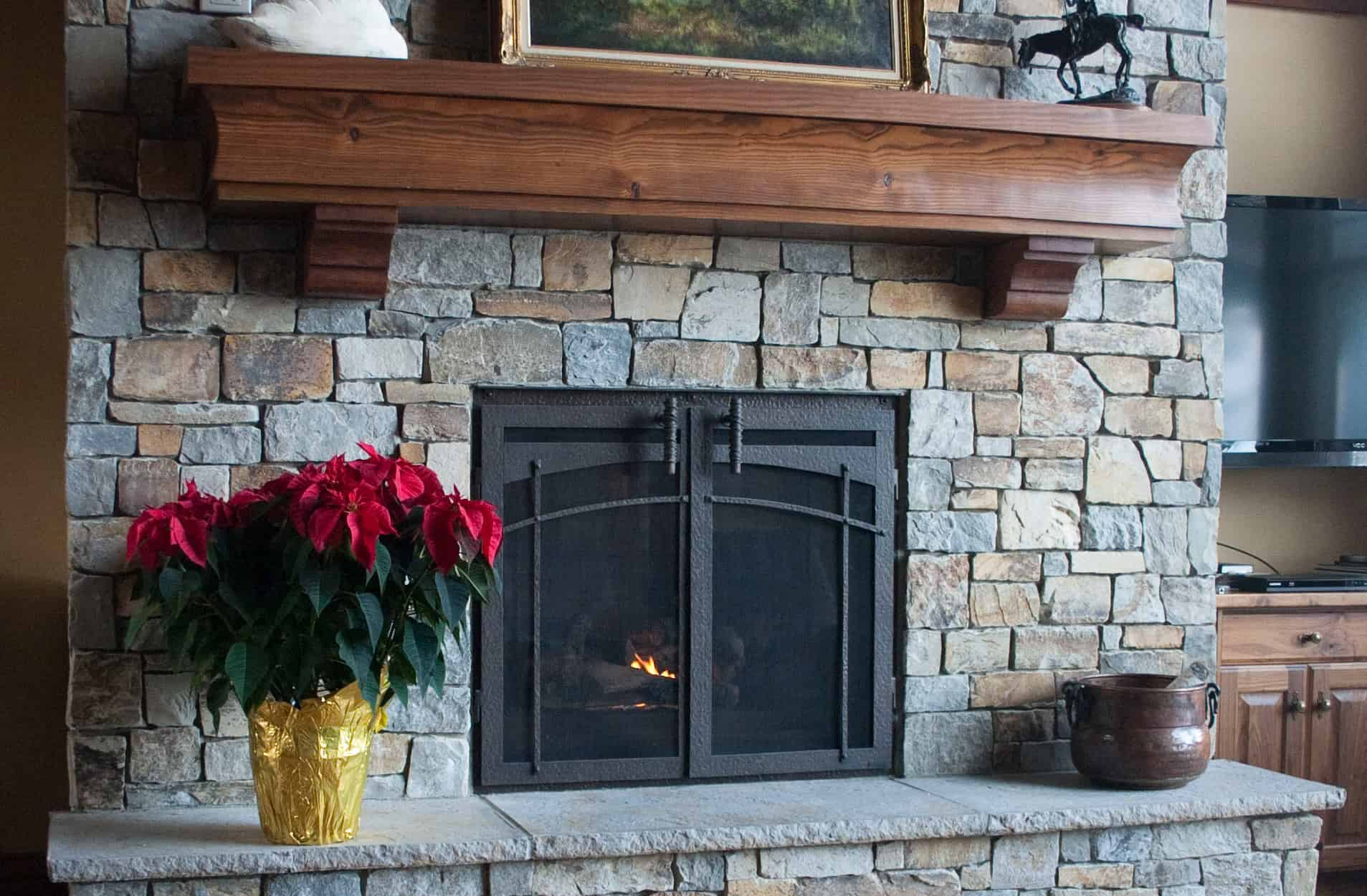 For your fireplace, you do not want to use traditional barn doors as they are typically made out of wood.