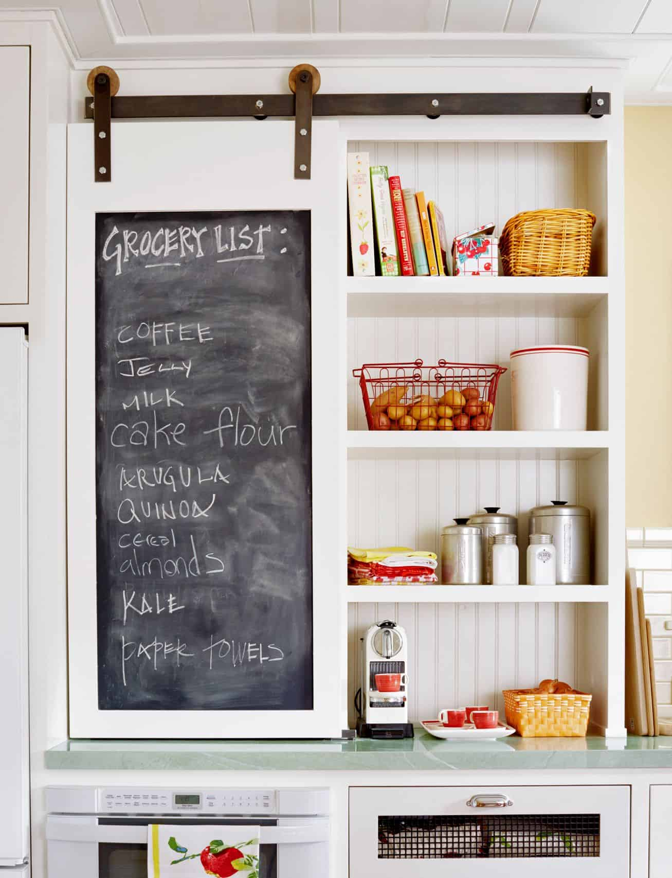 How cool is a chalkboard barn door cabinet?