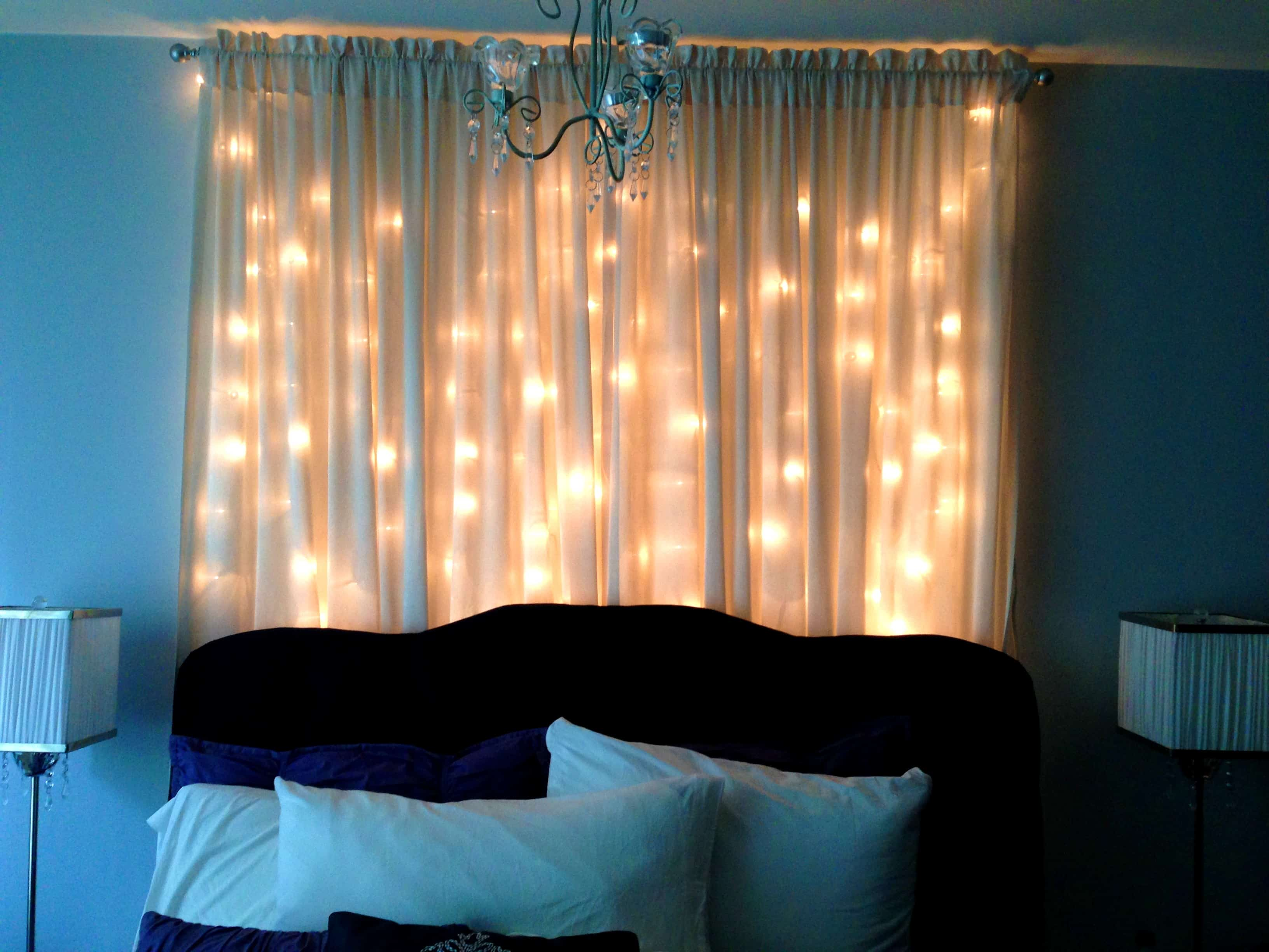 An easy way to create that charming effect while using a curtain full of lights is placing the lights directly on the window and placing the curtains on top