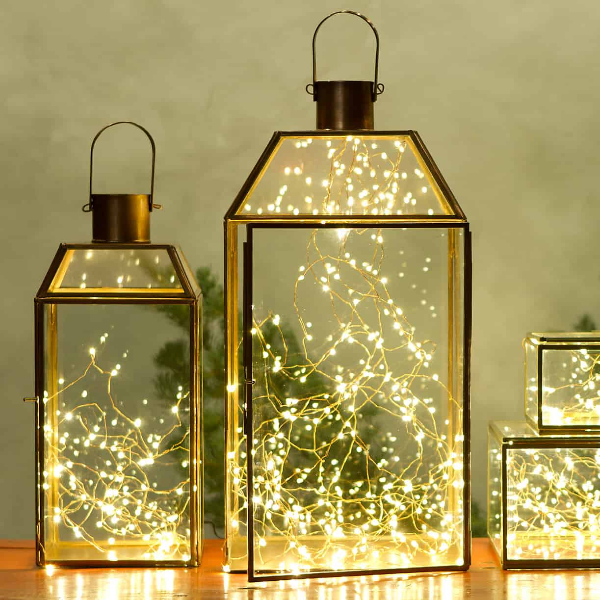 Incorporating Christmas fairy lights inside of any lantern case can give you a bolder lighting fixture than a simple lantern would.