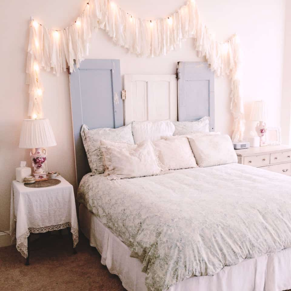 Using Christmas lights as part of your headboard decor creates a shabby chic decor space that is simple and intriguing all at once.