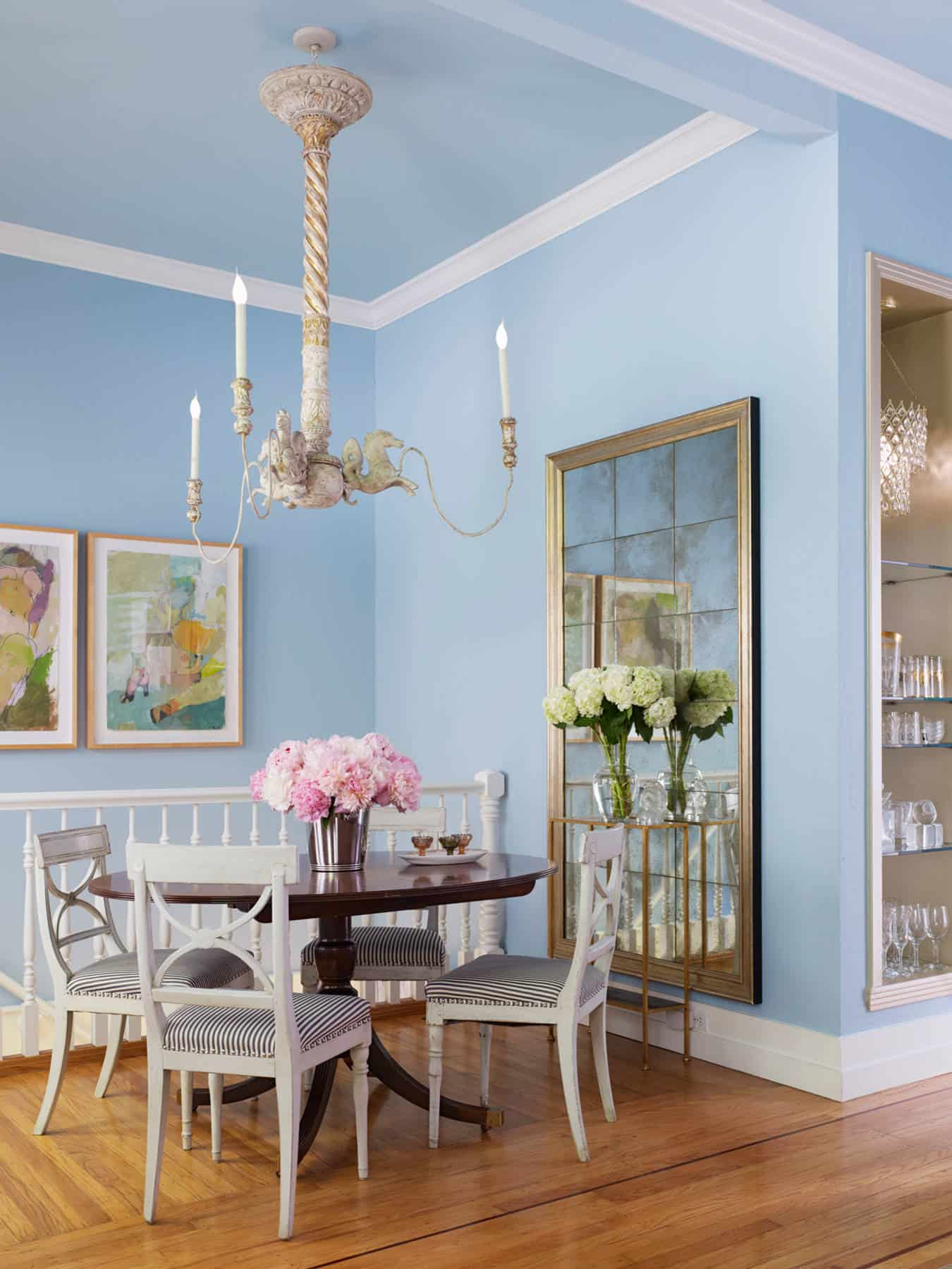 Take it a step further and use this color in your dining room space for a feminine charm that flows throughout.