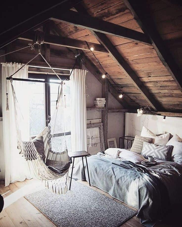 attic bedroom with hanging chair