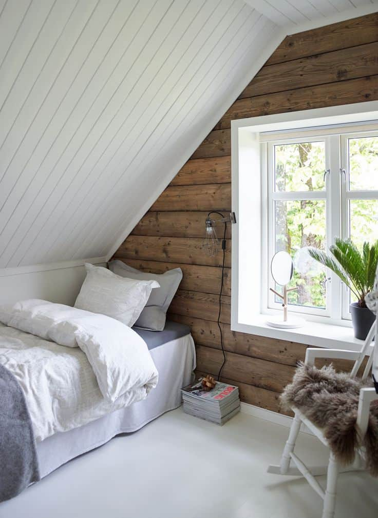 attic bedroom with wood accent wall