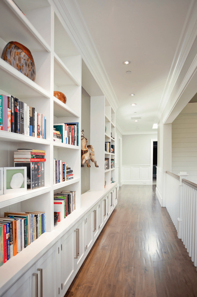 If you have a long hallway and can't figure out how to fill the space a large bookshelf is a way to go