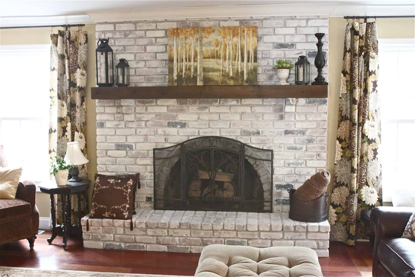 brick fireplace wit german smear 10 Ways To Refresh Your Brick Fireplace