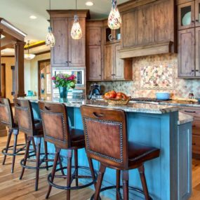 Blue is a beautiful color to add into a rustic kitchen because it just flows well.