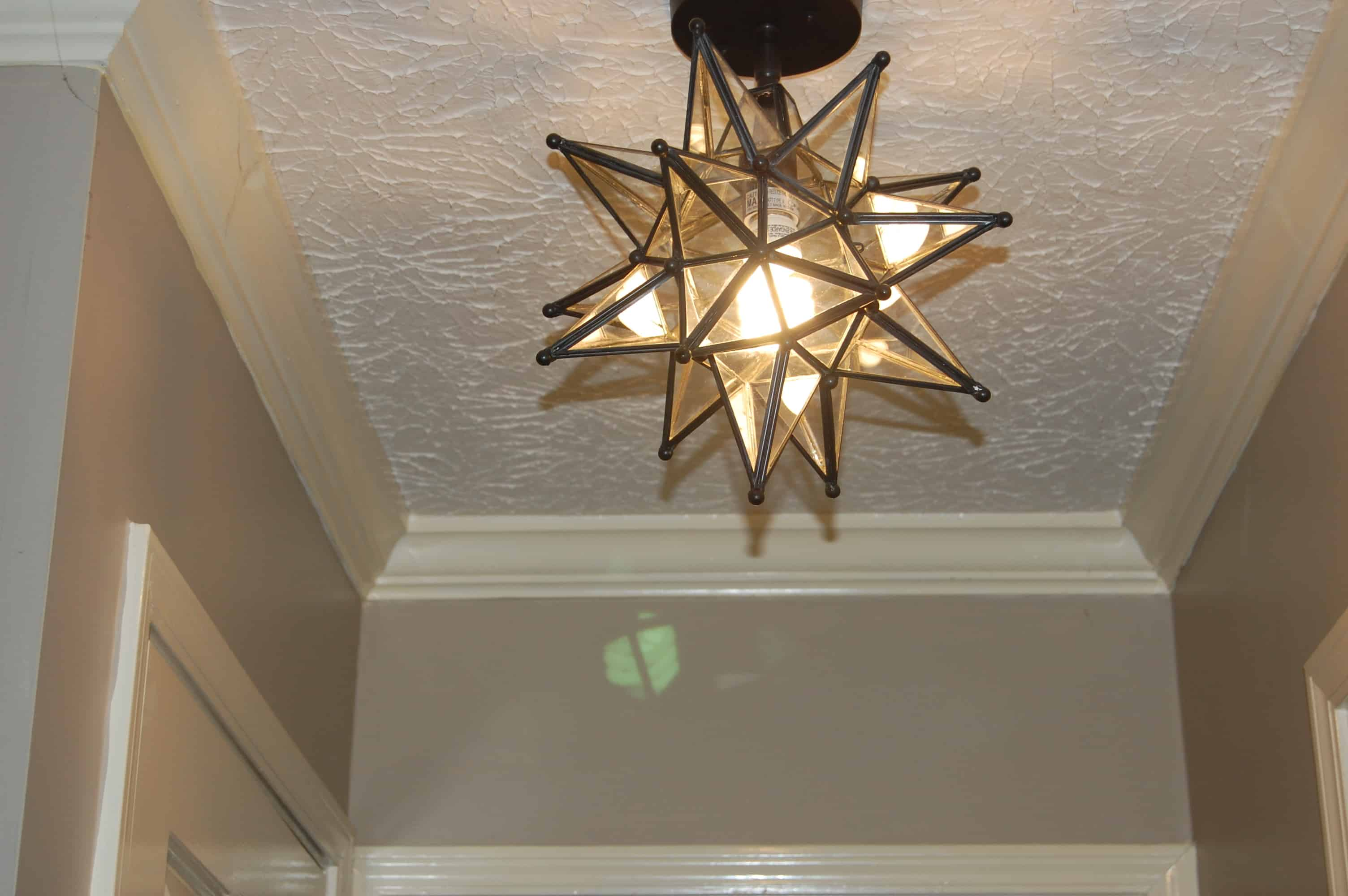 Use more than one light fixture for a bolder effect with grander star power throughout. You can also use different size light fixture for a modern feel on this trend