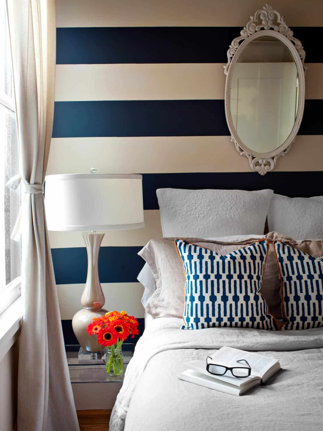 Stripes are great in the bedroom because they expand the space while bringing a new color scheme to the room.
