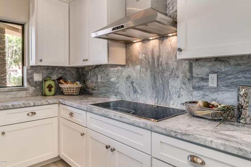 white kitchen with gray marble backsplash