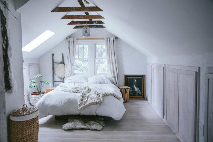 white textural attic bedroom 900x600 15 Attic Bedrooms That Will Make You Want to Clean Out Upstairs ASAP