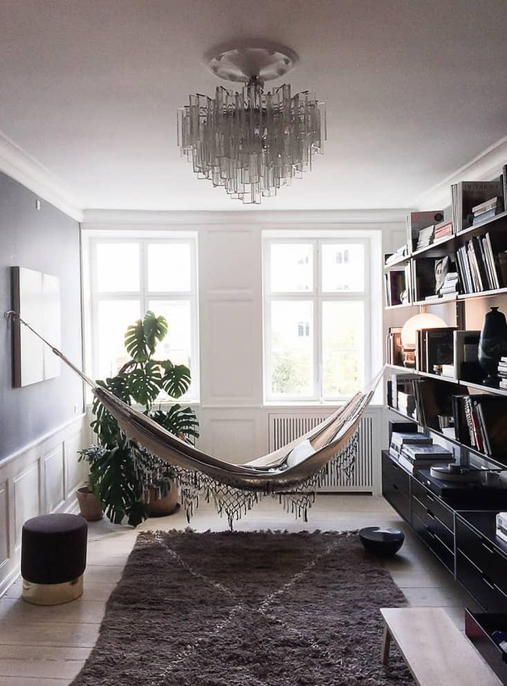 Elegant hammock over over a Moroccan Beni Quarain Rug 15 Indoor Hammocks That Will Ignite Everyones Relaxation