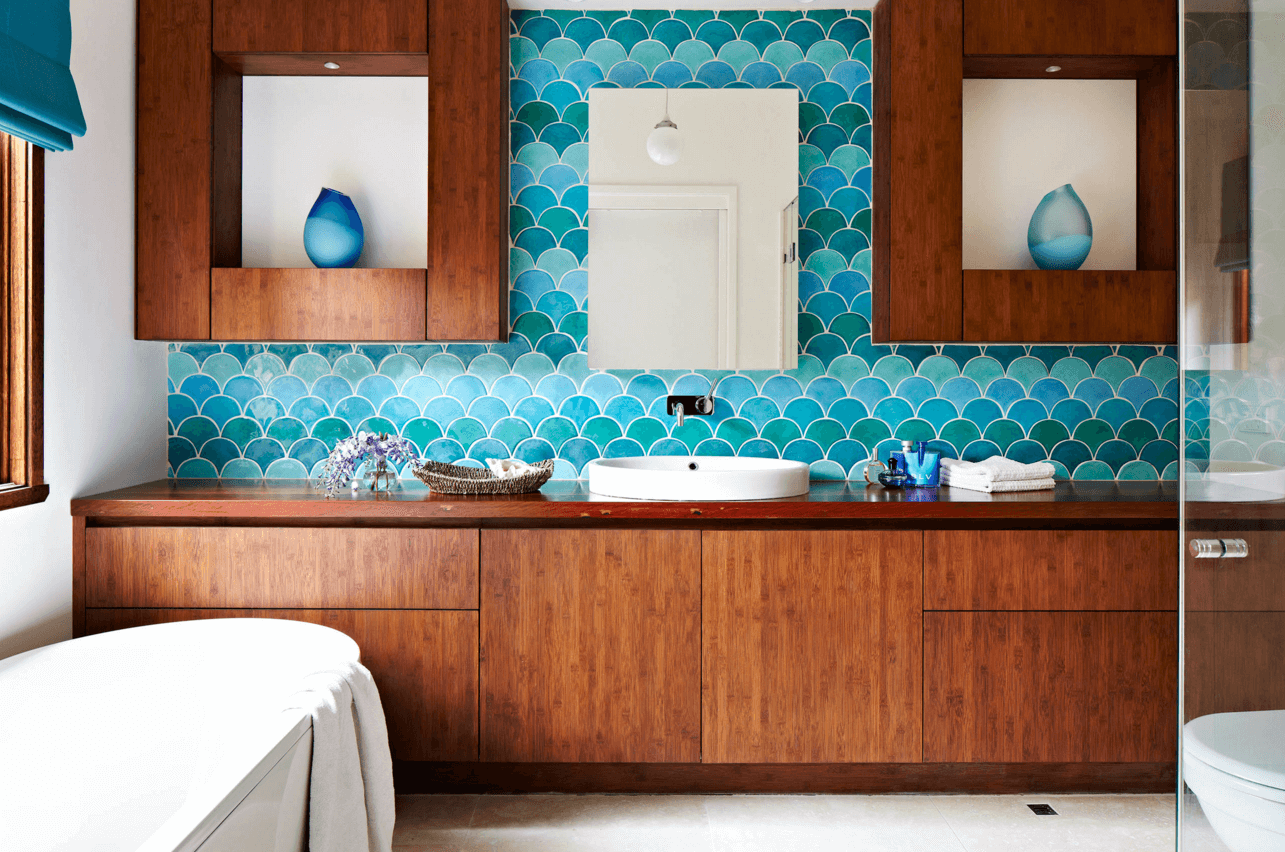 Colorful glass tiles work because they bring color while still being perfectly chic in the bathroom space.