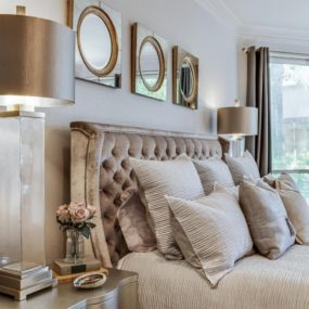 A beautiful velvet headboard adds a feminine touch that is difficult to recreate otherwise.