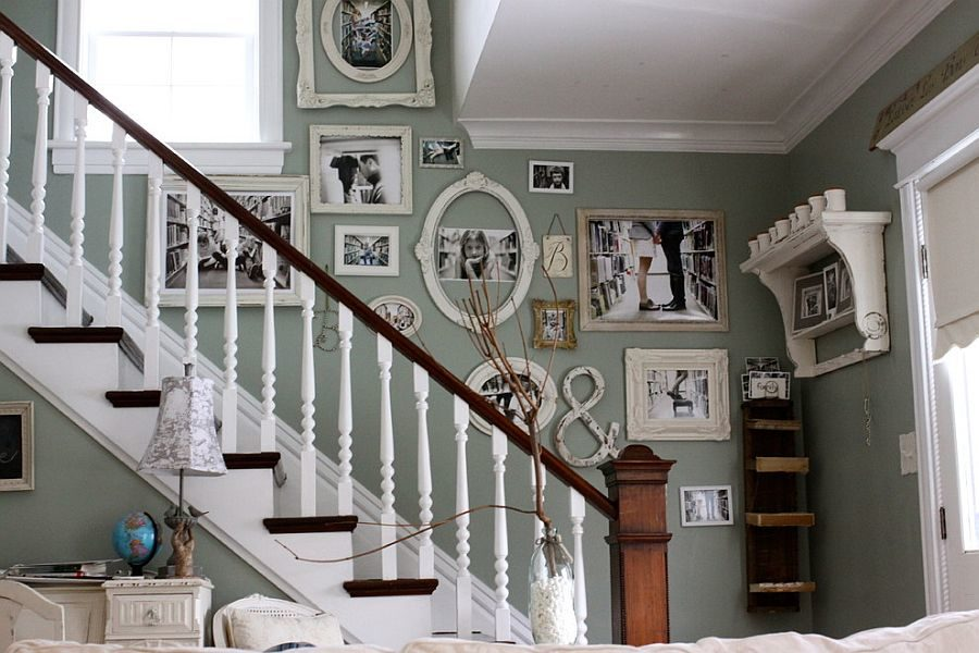 Staircase wall filled with family photos 900x600 15 Unique and Trendy Staircase Decorations