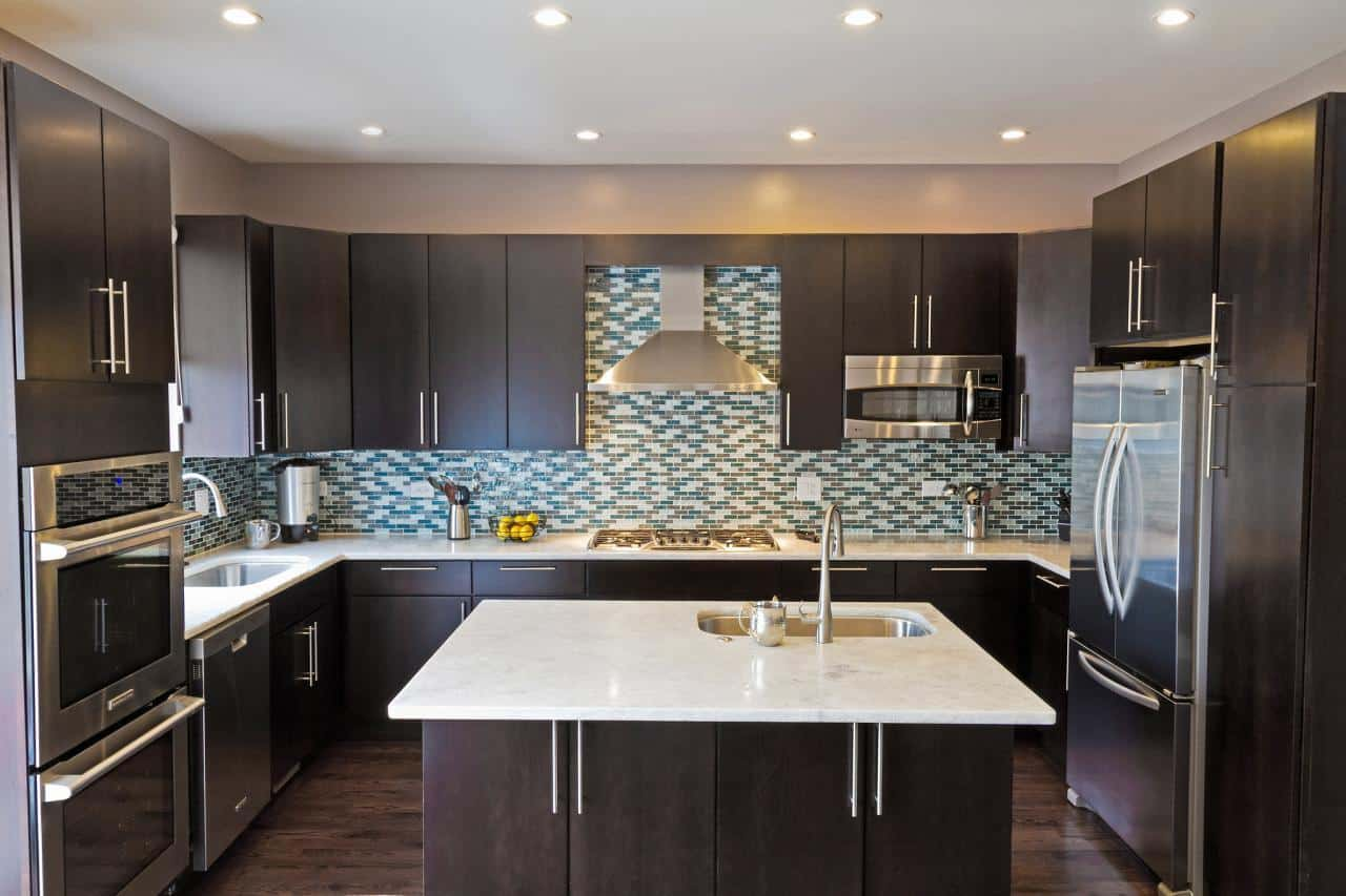 Even though darker cabinets can be a bit shrinking to a room