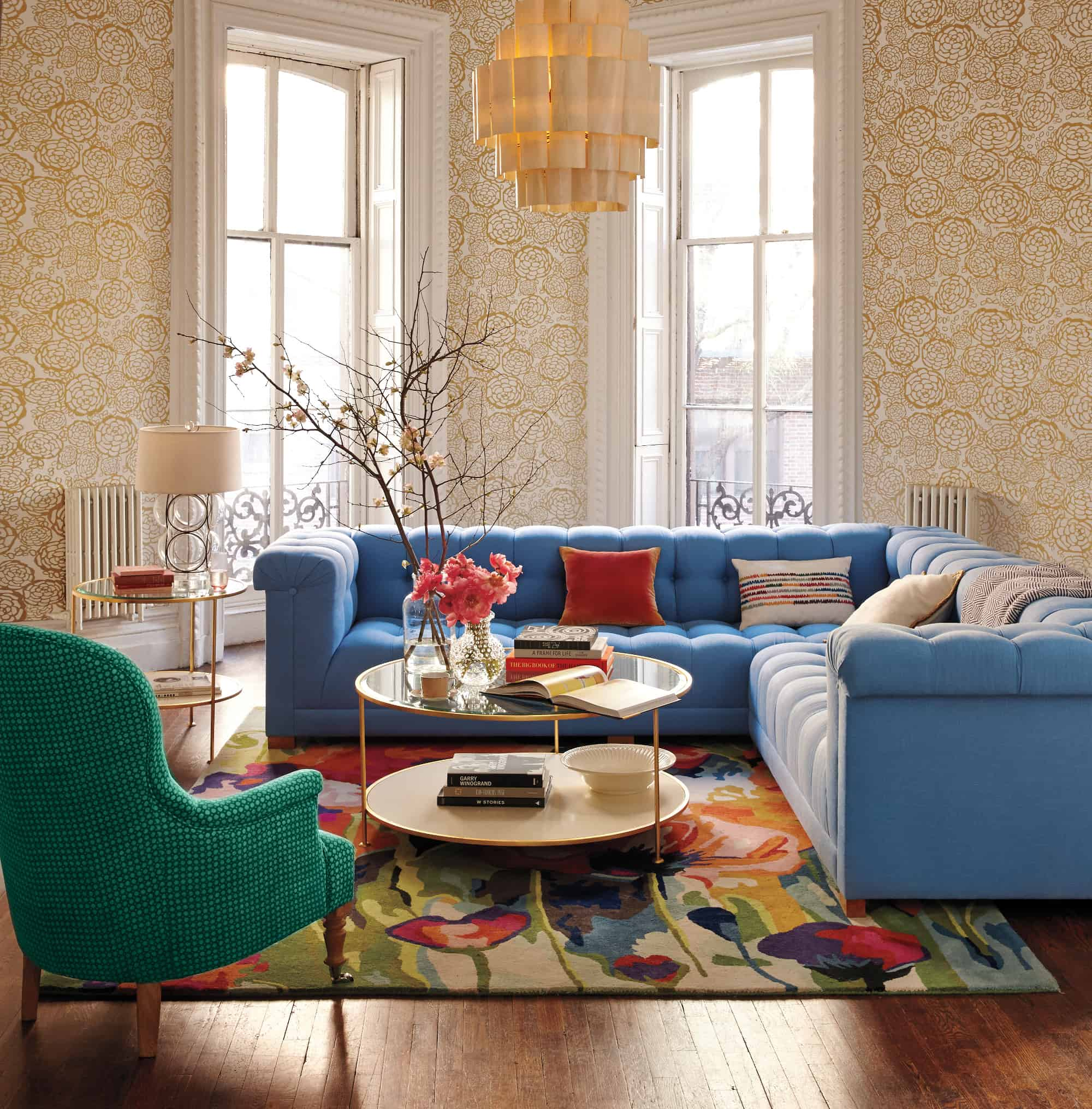 Color blocking with linen sofas and chairs is a modern way of adding something extra to your traditional mid-century decor