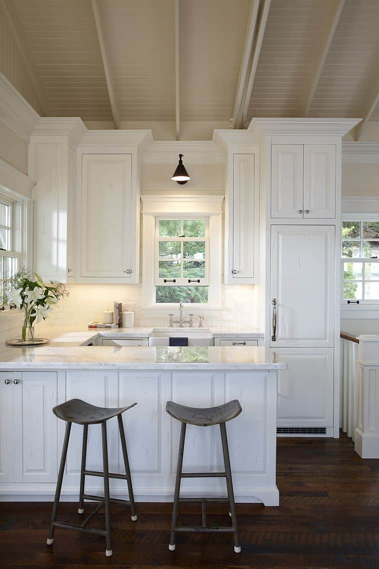 An all-white kitchen works because it is bright, crisp and makes sense.